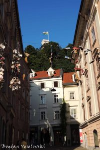 24.  Shoes & the tower of Ljubljana Castle seen from Pod Trančo