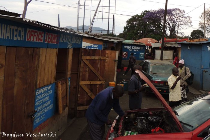 Mechanic next to 'Rasta Barber Shop' in Blantyre