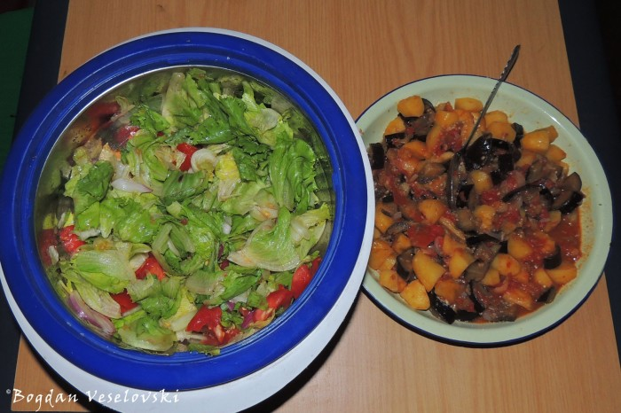 Vegetable mix (potatoes, eggplants, onion & tomatoes) with fresh salad (green salad, onion & tomatoes)